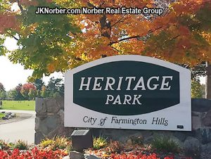Heritage Park in Farmington Hills sign at the front drive with autumn foliage