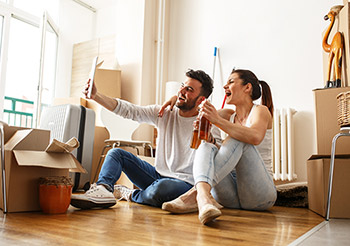 New Homeowners celebrate unpacking living room boxes