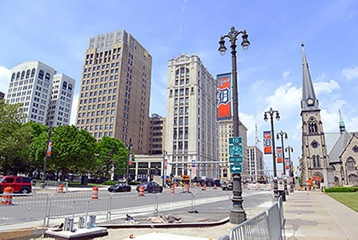 Detroit street view with pendants of Detroit Tigers on the lightposts.