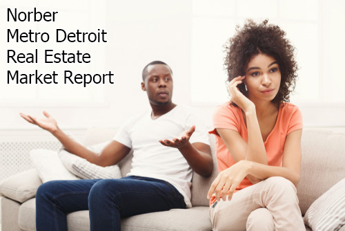 Young couple on couch, man's palms raised up with a curious look, woman has back turned on him using her phone, words say Norber and Metro Detroit Real Estate Market