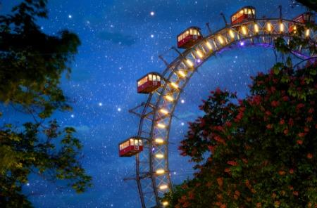 amusement park ride against night sky