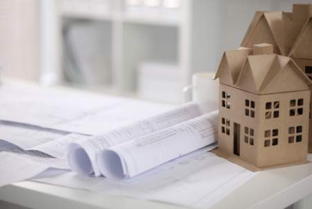 new construction papers with cartoon house on the side